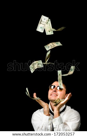 Young handsome man and Money falling - stock photo