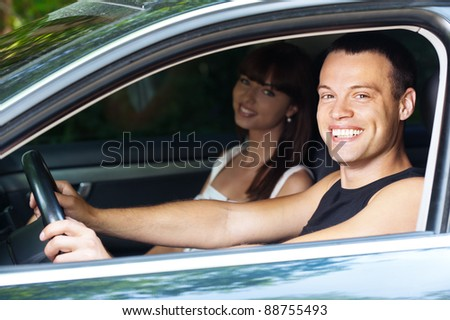 young handsome man and woman sitting car background summer green park - stock photo