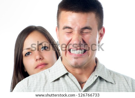 Young handsome man annoyed by his girlfriend. - stock photo