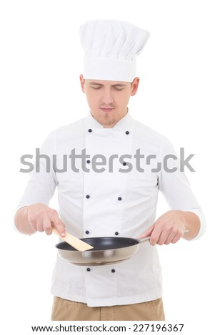 young handsome man chef in uniform holding frying pan isolated on white background - stock photo