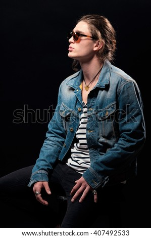 Young handsome man. Handsome men. Jeanswear. Casual style. Toned image. - stock photo
