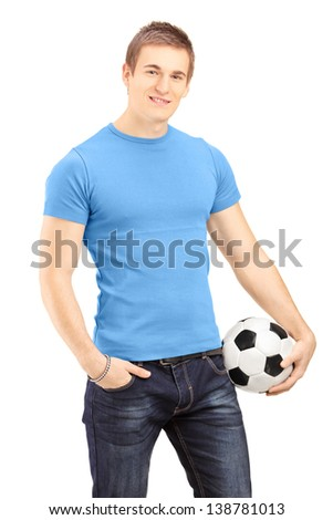 Young handsome man holding a soccer ball, isolated on white background - stock photo