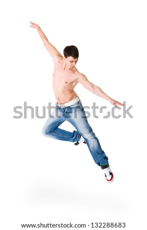 young handsome man in blue jeans jumping  isolated on white background - stock photo