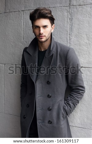 Young handsome man in coat - stock photo