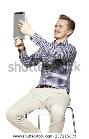 Young handsome man is making to himself a selfie. - stock photo