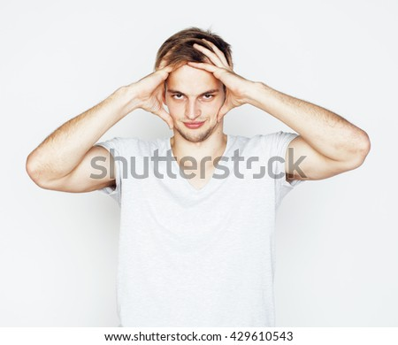 young handsome man on white background gesturing, pointing, posing emotional, cute guy sexy - stock photo