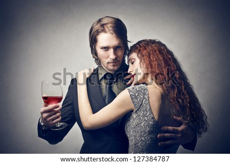 young handsome man proud of his beautiful girlfriend - stock photo