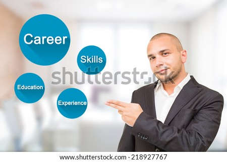 Young handsome man shows important attributes in career - stock photo