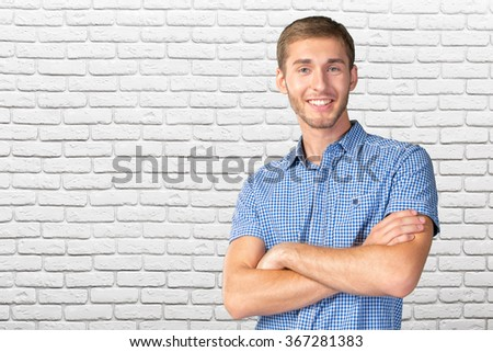 Young  handsome man smiling - stock photo