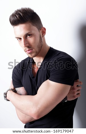 young handsome man. Studio fashion portrait. Fashion color - stock photo