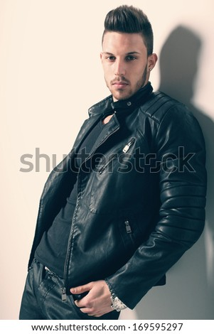 young handsome man. Studio fashion portrait. Fashion color  - stock photo