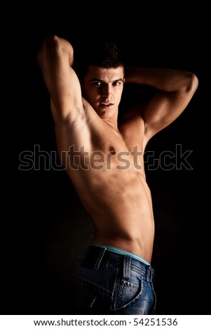 young handsome man, studio shot - stock photo
