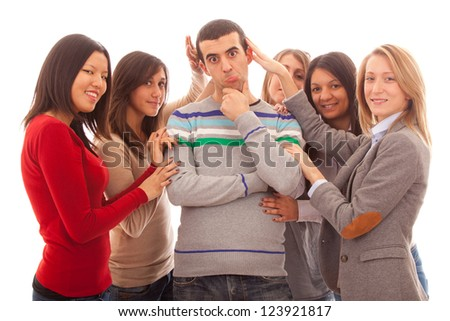 Young Handsome Man with Many Girls Around - stock photo