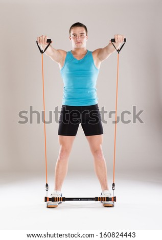Young handsome man with perfect body in sport clothes. - stock photo