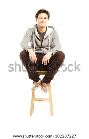 Young handsome man with smirk on face against white background - stock photo
