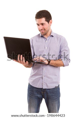 Young handsome man working with laptop computer - stock photo
