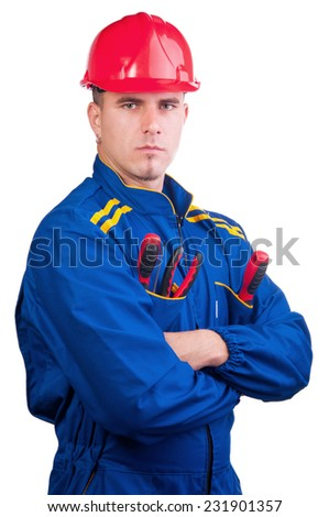 Young handsome mechanic with hard hat and tools and in overalls isolated on white. - stock photo
