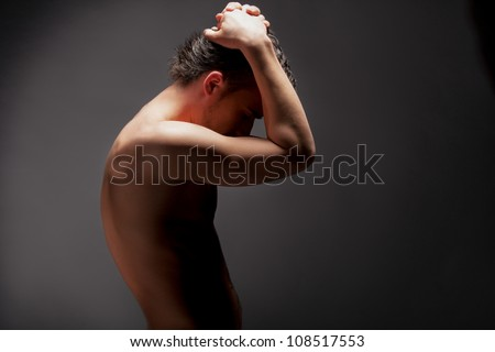 young handsome muscular man - stock photo
