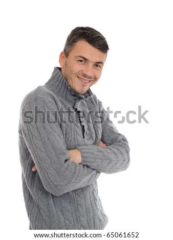 Young handsome possitive man in warm winter casual clothes smiling. isolated on white background - stock photo