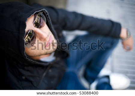 Young handsome problematic boy looking up - stock photo