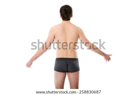 Young handsome shirtless man with arms wide open. - stock photo