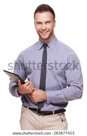 Young handsome smiling man with tablet computer isolated over white background - stock photo