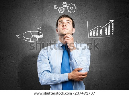 Young handsome thoughtful man thinking over something - stock photo
