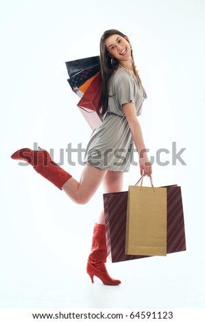 Young happiness woman holding several shopping bags - stock photo