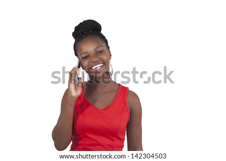 Young happy african woman talking into her cell phone on white background - stock photo