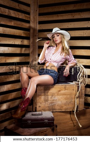 Young, happy and sexy cowgirl in western style - stock photo