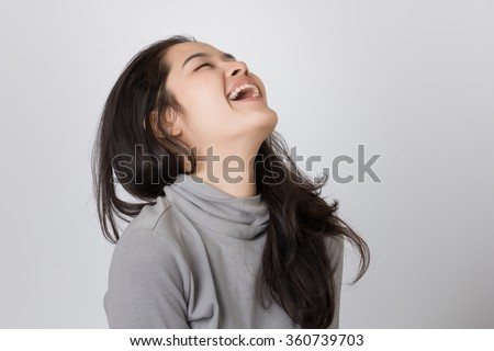 Young happy Asia woman is laughing. - stock photo