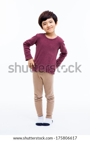 Young happy Asian boy isolated on white background.  - stock photo
