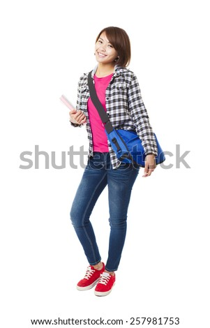 Young happy asian student with books and isolated on white - stock photo