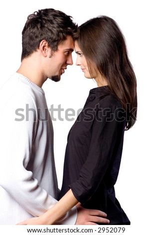 Young happy attractive smiling couple hugging, isolated on white background - stock photo
