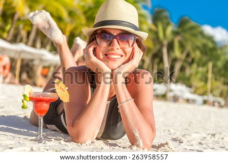 young happy beautiful woman enjoying summer vacation on tropical sand beach, sunbathing, outdoor portrait - stock photo