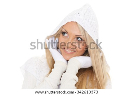 Young happy beautiful woman in winter clothes stands on a white background. - stock photo