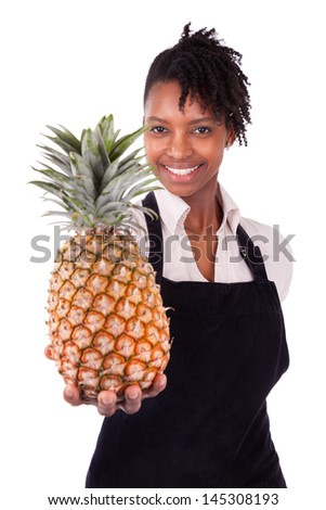Young happy black / african american woman holding a fresh melon isolated on white background - stock photo
