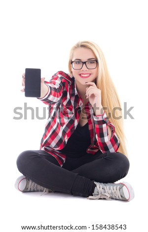young happy blondie woman sitting and showing mobile phone in her hand isolated on white background - stock photo