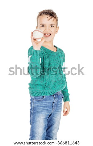 young happy boy with wooden baseball ball isolated on white studio background. - stock photo