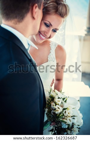 Young happy bride and groom - stock photo