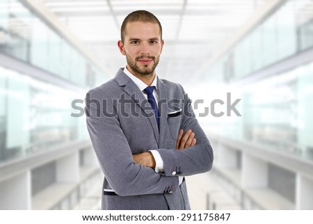 young happy business man at the office - stock photo