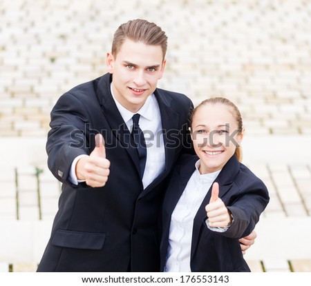 Young happy business people enjoy their promotion - stock photo