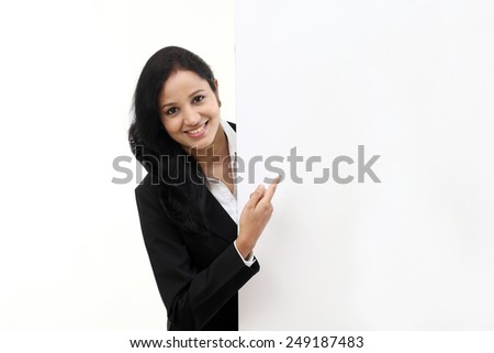 Young happy business woman showing blank signboard, isolated on white background - stock photo