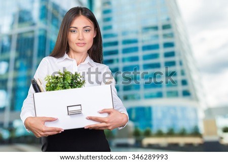 Young happy business woman with a box to move to a new office.  - stock photo