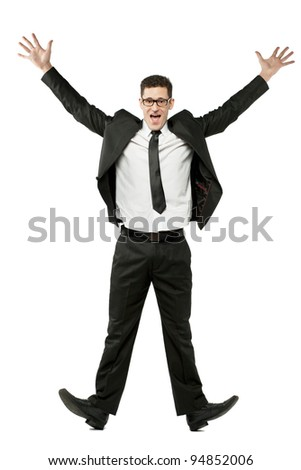 Young happy businessman jumps in black suit on white. - stock photo