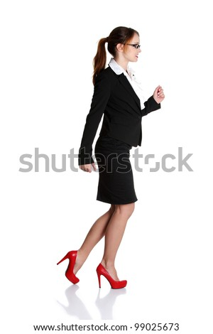 Young happy businesswoman in a rush. Isolated on white - stock photo