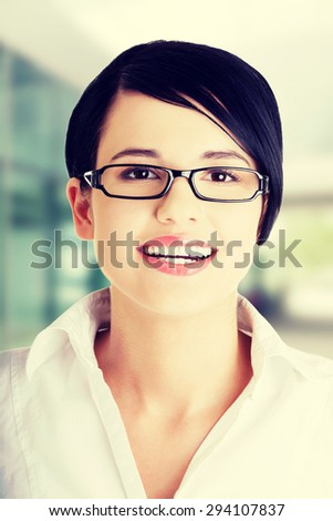 Young happy businesswoman in glasses portrait - stock photo