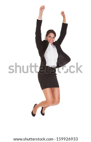 Young Happy Businesswoman Raising Arm Over White Background - stock photo