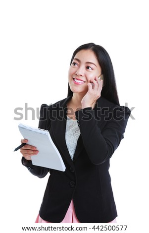 Young happy businesswoman talking on mobile phone and holding note paper. Isolated on white background. Positive human emotion. Studio shot. - stock photo