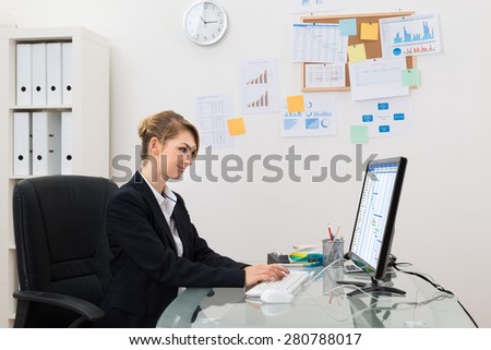 Young Happy Businesswoman Working On Computer In Office - stock photo